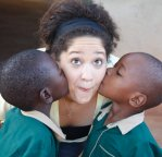 Ashley getting kisses from orphans